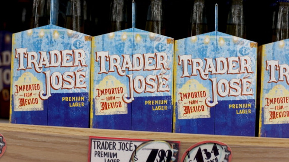 PINECREST, FL - OCTOBER 18: Trader Joe's beer is seen on the shelf during the grand opening of a Trader Joe's on October 18, 2013 in Pinecrest, Florida. Trader Joe's opened its first store in South Florida where shoppers can now take advantage of the California grocery chains low-cost wines and unique items not found in other stores. About 80 percent of what they sell is under the Trader Joe's private label.