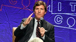 LOS ANGELES, CA - OCTOBER 21: Fox News anchor Tucker Carlson speaks during Politicon 2018 at Los Angeles Convention Center on October 21, 2018 in Los Angeles, California.