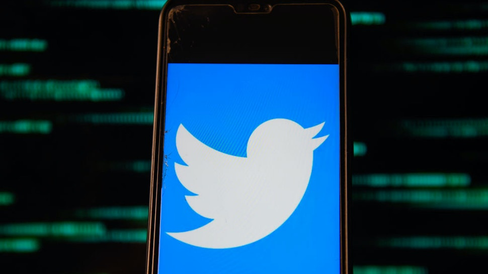 POLAND - 2020/07/15: In this photo illustration a Twitter logo is seen displayed on a smartphone.