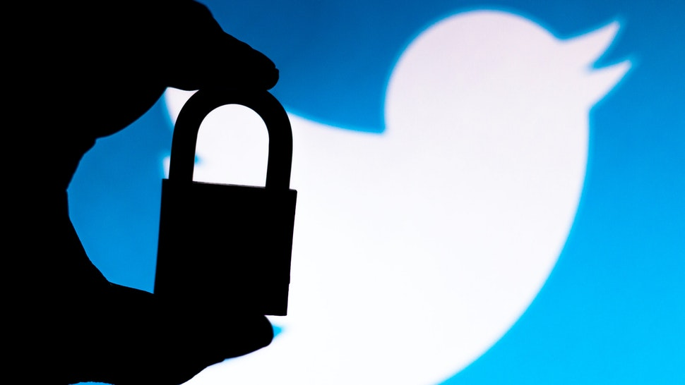 BRAZIL - 2020/07/11: In this photo illustration a padlock appears next to the Twitter logo. Online data protection/breach concept. Internet privacy issues.