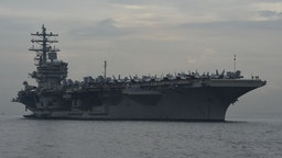 """This photo taken on June 26, 2018 shows the nuclear-powered aircraft carrier USS Ronald Reagan (CVN-76) anchored off Manila bay. - A US aircraft carrier visited the Philippines on June 26, the third such call in four months, as its commander cited America's """"enduring presence"""" in a region where China's military aims have raised tensions. (Photo by TED ALJIBE / AFP) (Photo credit should read TED ALJIBE/AFP via Getty Images)"""