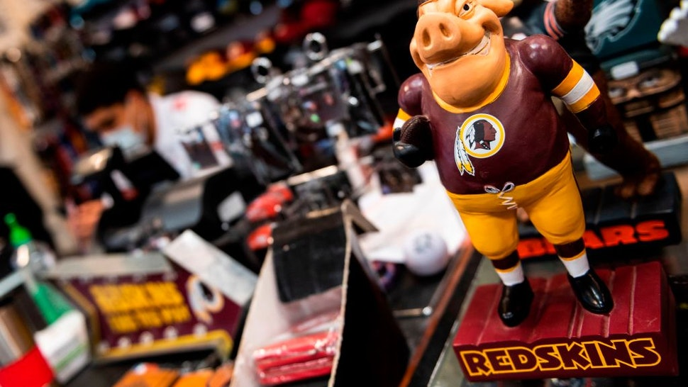 Washington Redskins merchandise is seen for sale at a sports store in Fairfax, Virginia on July 13, 2020. - The Washington Redskins confirmed on July 13 that the team is changing its name following pressure from sponsors over a word widely criticized as a racist slur against Native Americans. (Photo by ANDREW CABALLERO-REYNOLDS / AFP)