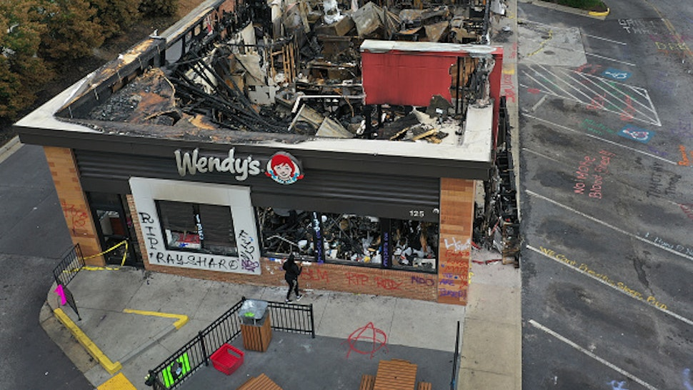 ATLANTA, GEORGIA - JUNE 17: In this aerial photo, the Wendy's restaurant that was set on fire by demonstrators after Rayshard Brooks was killed is seen on June 17, 2020 in Atlanta, Georgia. The site has become a place of remembrance for Mr. Brooks, who was killed by police while fleeing after a struggle during a field sobriety test in the Wendy's parking lot.