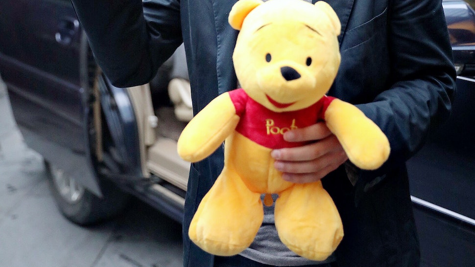 American actor Jesse Eisenberg holding a Pooh Bear toy given by fans is seen on June 30, 2018 in Shanghai, China. (Photo by Visual China Group via Getty Images)