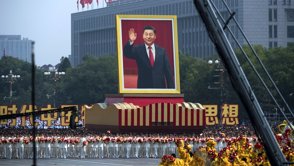 A giant portrait of Chinese President Xi Jinping is carried atop a float at a parade to celebrate the 70th Anniversary of the founding of the People's Republic of China in 1949 , at Tiananmen Square on October 1, 2019 in Beijing, China.