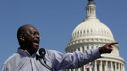 """WASHINGTON, DC - APRIL 16: Former Republican presidential candidate Herman Cain speaks at the """"Cain's Revolution on the Hill"""" Tax Day Rally at the U.S. Capitol April 16, 2012 in Washington, DC. Cain spent the day promoting his 9-9-9 tax code plan in advance of tomorrow, the day that Americans are required to file their income taxes this year. (Photo by"""