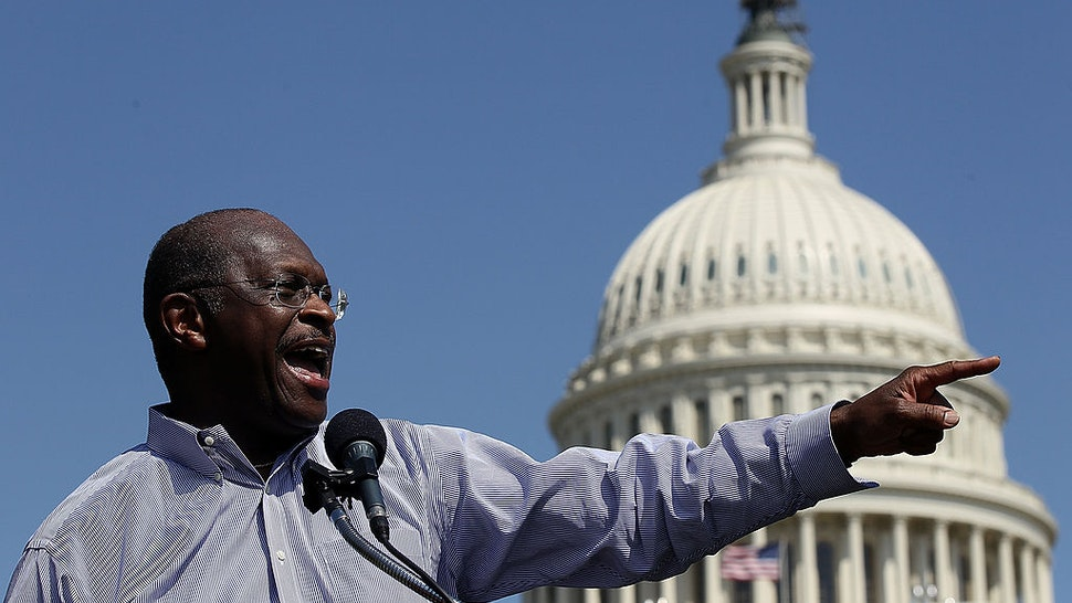 "WASHINGTON, DC - APRIL 16: Former Republican presidential candidate Herman Cain speaks at the ""Cain's Revolution on the Hill"" Tax Day Rally at the U.S. Capitol April 16, 2012 in Washington, DC. Cain spent the day promoting his 9-9-9 tax code plan in advance of tomorrow, the day that Americans are required to file their income taxes this year. (Photo by"