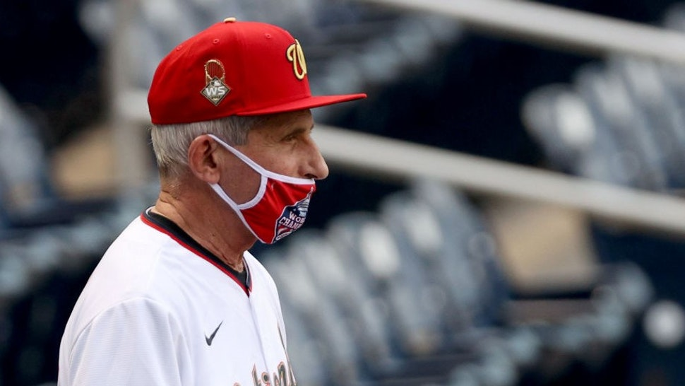 WASHINGTON, DC - JULY 23: Dr. Anthony Fauci, director of the National Institute of Allergy and Infectious Diseases looks on before throwing out the ceremonial first pitch prior to the game between the New York Yankees and the Washington Nationals at Nationals Park on July 23, 2020 in Washington, DC. Photo by