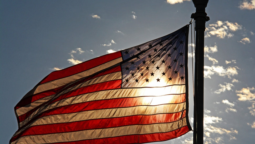 Sun highlights the colors of the american flag.