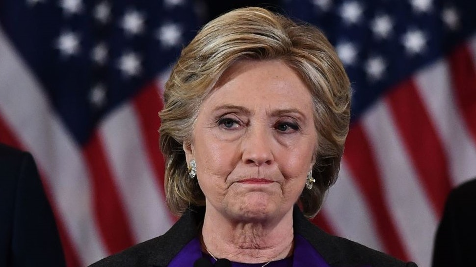 TOPSHOT - US Democratic presidential candidate Hillary Clinton makes a concession speech after being defeated by Republican president-elect Donald Trump in New York on November 9, 2016. / AFP PHOTO / JEWEL SAMAD (Photo credit should read
