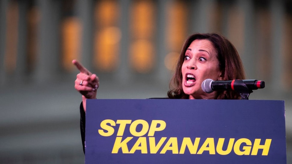 WASHINGTON, DC - OCTOBER 4: U.S. Sen. Kamala Harris (D-CA) speaks to protestors rallying against Supreme Court nominee Judge Brett Kavanaugh on Capitol Hill, October 4, 2018 in Washington, DC. Kavanaugh's confirmation process was halted for less than a week so that FBI investigators could look into allegations by Dr. Christine Blasey Ford, a California professor who who has accused Kavanaugh of sexually assaulting her during a party in 1982 when they were high school students in suburban Maryland. (Photo by