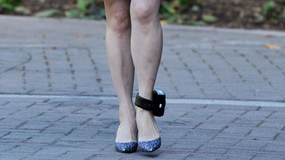 An ankle monitor is seen on Huawei Chief Financial Officer, Meng Wanzhou as she leaves her Vancouver home to appear in British Columbia Supreme Court in Vancouver on September 30, 2019. - The 47-year-old Huawei chief financial officer was detained during a stopover at the Vancouver airport last December on a US warrant. The US wants to put Meng on trial for fraud for allegedly violating Iran sanctions and lying about it to US banks -- accusations her lawyers dispute. (Photo by Don MacKinnon / AFP) (Photo by