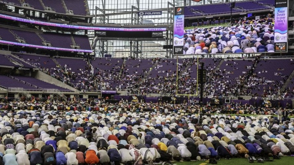 Muslim worshippers kneel in prayer at the US Bank Stadium during celebrations for Eid al-Adha on August 21, 2018 in Minneapolis, Minnesota.