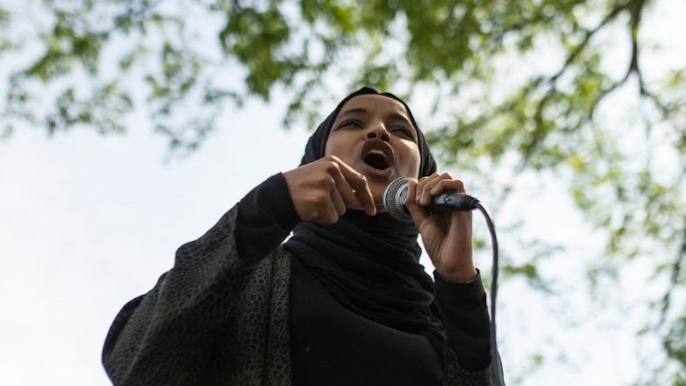 Rep. Ilhan Omar (D-MN) speaks to a crowd gathered for a march to defund the Minneapolis Police Department on June 6, 2020 in Minneapolis, Minnesota. The march commemorated the life of George Floyd who was killed by members of the MPD on May 25. (Photo by