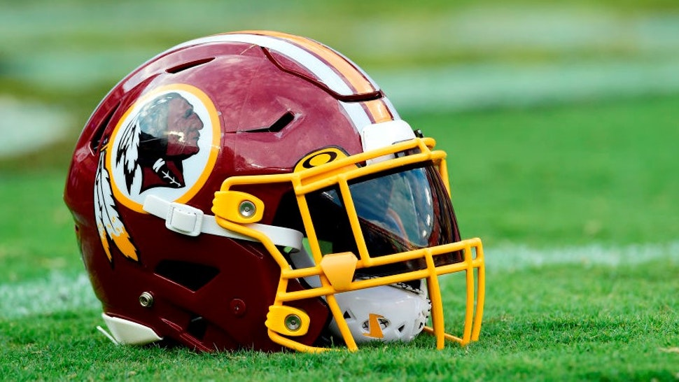 LANDOVER, MD - AUGUST 15: A Washington Redskins helmet sits on the field before a preseason game between the Cincinnati Bengals and Redskins at FedExField on August 15, 2019 in Landover, Maryland. (Photo by