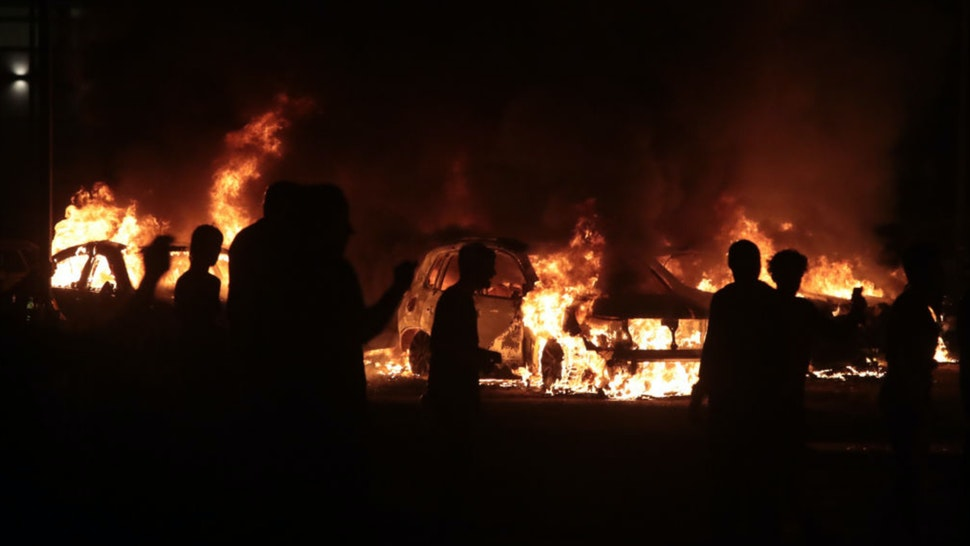 Fires burn around downtown during a second night of rioting on August 24, 2020 in Kenosha, Wisconsin.