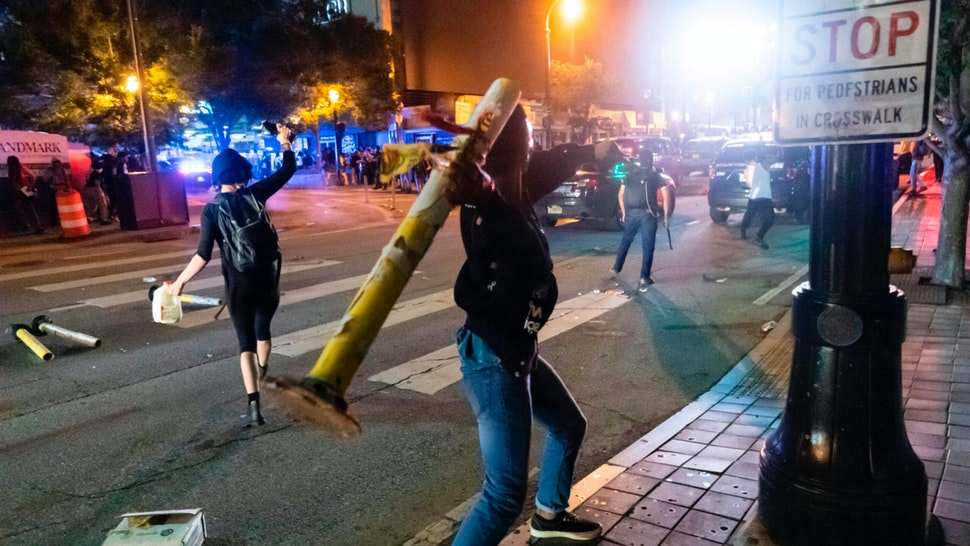Protesters face off with police during rioting and protests in Atlanta on May 29, 2020. - The death of George Floyd on May 25 while under police custody has sparked violent demonstrations across the US.
