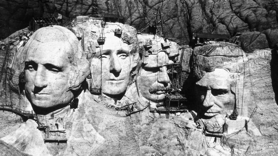 The memorial at Mount Rushmore, South Dakota under construction. The four heads are those of Presidents George Washington (1732 - 1799), Thomas Jefferson (1743 - 1826), Theodore Roosevelt (1858 - 1919) and Abraham Lincoln (1809 - 1865).