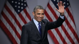 U.S. President Barack Obama waves after he spoke during the SelectUSA Investment Summit March 23, 2015 in National Harbor, Maryland.