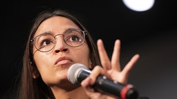 U.S. Representative Alexandria Ocasio-Cortez, a Democrat from New York, speaks during a campaign rally for Senator Bernie Sanders, an Independent from Vermont and 2020 presidential candidate, not pictured, in Sioux City, Iowa, U.S., on Sunday, Jan. 26, 2020. New polls showed the unsettled state of the Democratic primary days before the first voters weigh in at the Iowa caucuses, with front-runner status still unclear.