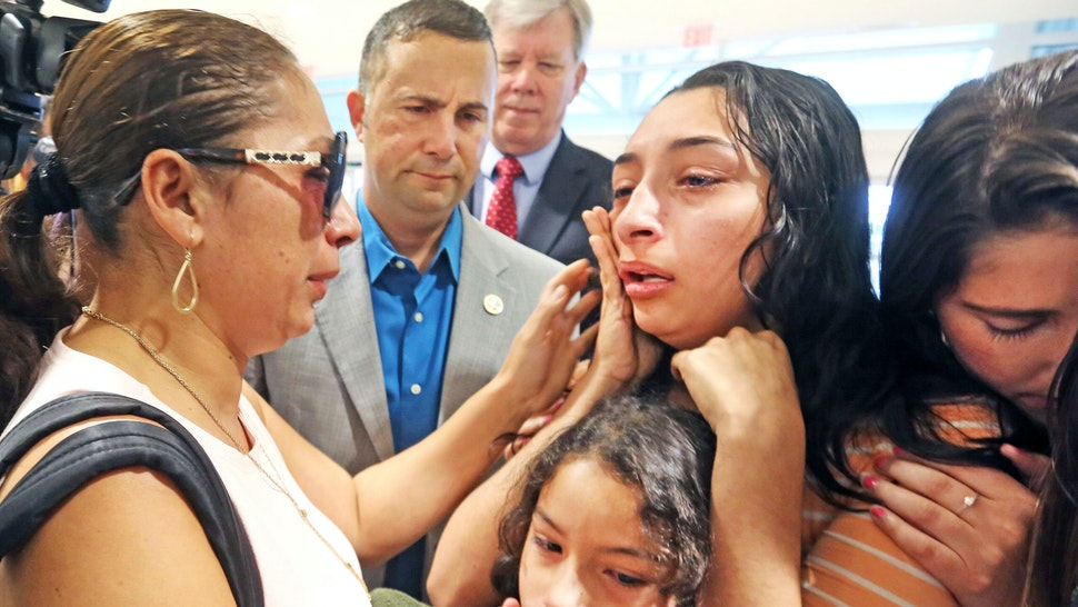 Alejandra Juarez, 38, left, has an emotional goodbye on Friday, Aug. 3, 2018, with her children, Pamela,16, Estela, 8, and Katie Aragon, right, of FWD.US at the Orlando International Airport. U.S Rep Darren Soto, second from left, looks on. Juarez has run out of options to keep her Davenport, Fla., family together and will be deported as U.S. Immigration and Customs Enforcement officials denied the Polk County Marine veteran's wife stay of removal request last week.