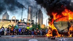 Protesters set a vehicle on fire during a protest following the death of George Floyd outside of the CNN Center next to Centennial Olympic Park in downtown Atlanta, Georgia, United States on May 29, 2020. It was announced Friday that Derek Chauvin, the former Minneapolis police officer caught on camera with his knee on Floyd√¢s neck, has been arrested and charged with third-degree murder and manslaughter. (Photo by Ben Hendren/Anadolu Agency via Getty Images)
