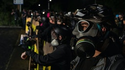 Protesters are seen during a standoff at a Portland police precinct in Portland, Oregon on August 15, 2020.