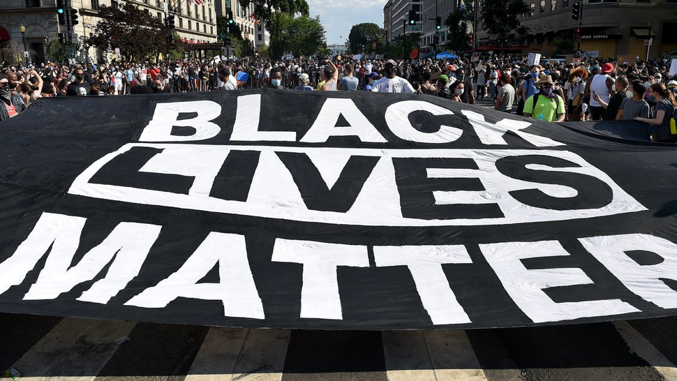 """Demonstrators deploy a """" Black Lives Matter"""" banner near the White House during a demonstration against racism and police brutality, in Washington, DC on June 6, 2020. - Demonstrations are being held across the US following the death of George Floyd on May 25, 2020, while being arrested in Minneapolis, Minnesota."""