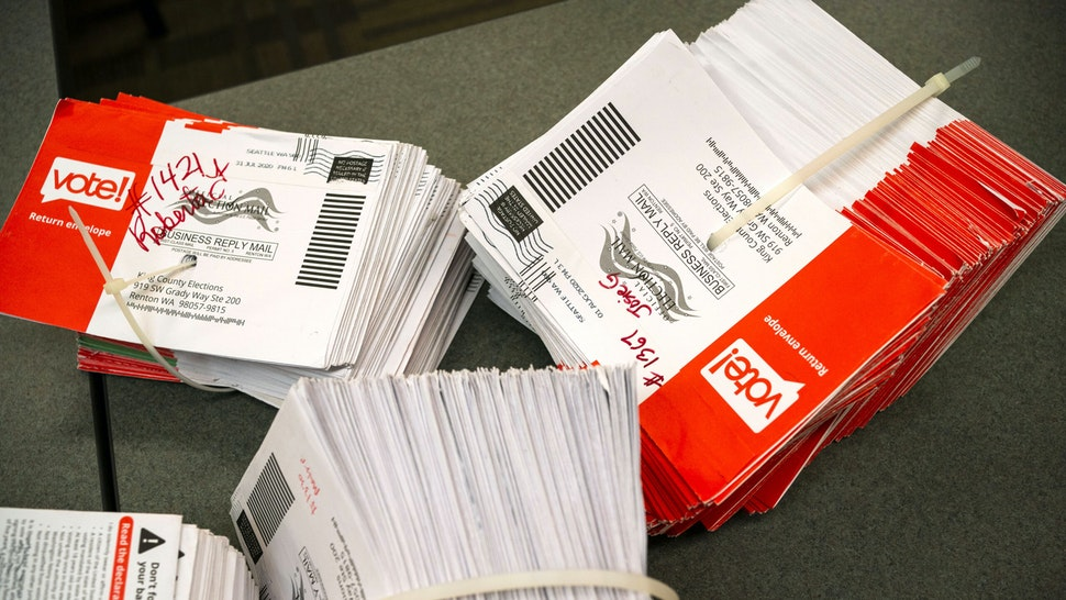 RENTON, WA - AUGUST 04: Opened ballot envelopes await storage at the King County Elections headquarters on August 4, 2020 in Renton, Washington. Today is election day for the primary in Washington state, where voting is done almost exclusively by mail.