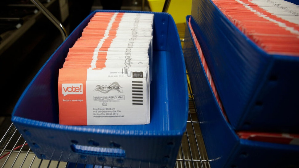 Vote-by-mail ballots for the August 4 Washington state primary are pictured at King County Elections in Renton, Washington on August 3, 2020.
