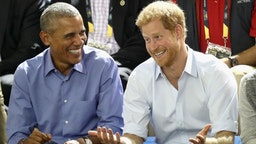 Former U.S. President Barack Obama and Prince Harry share a joke as they watch wheelchair baskeball on day 7 of the Invictus Games 2017 on September 29, 2017 in Toronto, Canada. (Chris Jackson/Getty Images for the Invictus Games Foundation)