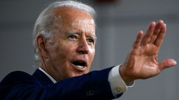 """US Democratic presidential candidate and former Vice President Joe Biden speaks during a campaign event at the William """"Hicks"""" Anderson Community Center in Wilmington, Delaware on July 28, 2020."""