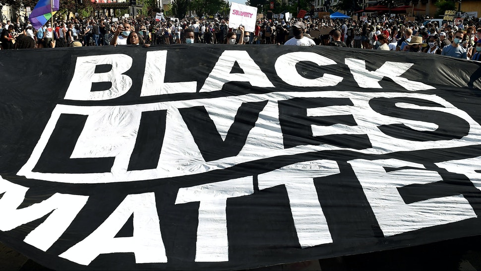 "TOPSHOT - Demonstrators deploy a "" Black Lives Matter"" banner near the White House during a demonstration against racism and police brutality, in Washington, DC on June 6, 2020. - Demonstrations are being held across the US following the death of George Floyd on May 25, 2020, while being arrested in Minneapolis, Minnesota."