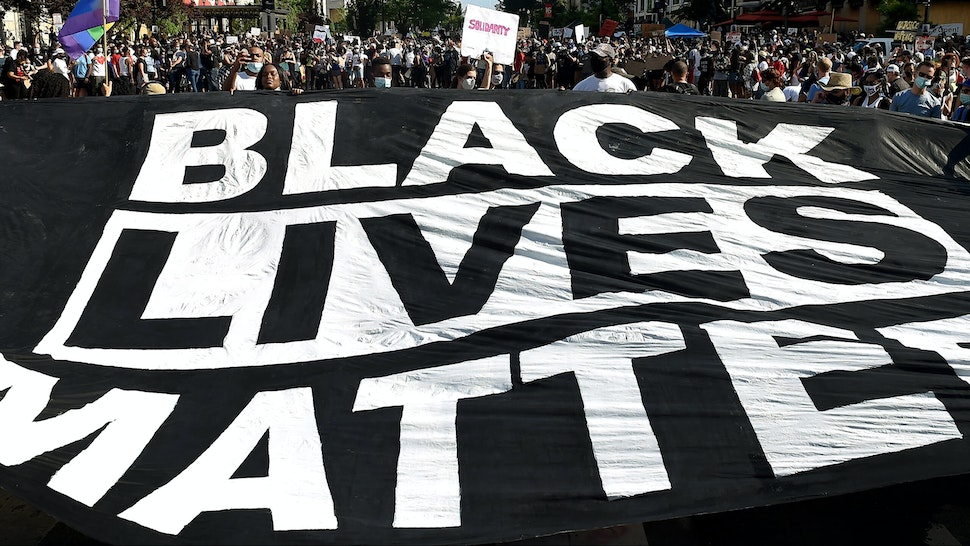 """TOPSHOT - Demonstrators deploy a """" Black Lives Matter"""" banner near the White House during a demonstration against racism and police brutality, in Washington, DC on June 6, 2020. - Demonstrations are being held across the US following the death of George Floyd on May 25, 2020, while being arrested in Minneapolis, Minnesota."""