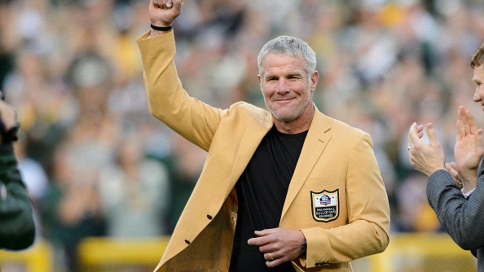 GREEN BAY, WI - OCTOBER 16: Former NFL quarterback Brett Farve looks on as he is inducted into the Ring of Honor during a halftime ceremony during the game between the Green Bay Packers and the Dallas Cowboys on October 16, 2016 at Lambeau Field in Green Bay, Wisconsin. The Cowboys defeated the Packers 30-16.