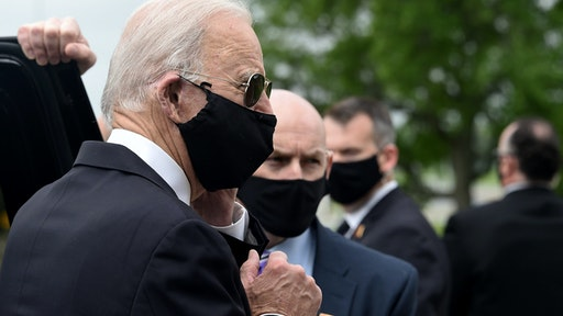 Democratic presidential candidate and former US Vice President Joe Biden (L) departs the Delaware Memorial Bridge Veteran's Memorial Park after paying respects to fallen service members in New Castle, Delaware, May 25, 2020.