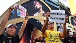 "Anti-Chinese Communist Party activists protest outside Staples Center ahead of the Lakers vs Clippers NBA season opener in Los Angeles on October 22, 2019. - Activists handed out free T-shirts displaying support for the Hong Kong protests after an NBA fan in Northern California raised enough money to pay for more than 10,000 shirts, according to the organizer who goes by the pseudonym ""Sun Lared"" as LeBron James of the Lakers suffers the brunt of people's anger after comments he made in response to the tweet from Houston Rockets GM Daryl Morey in support of Hong Kong protesters, and drawing the ire of the Chinese Communist Party. (Photo by Frederic J. BROWN / AFP)"