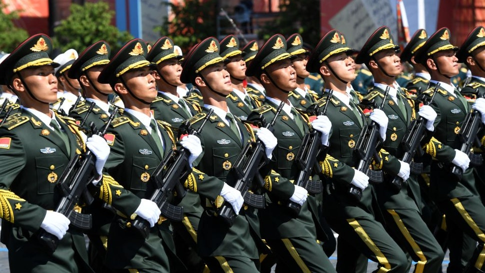 MOSCOW, RUSSIA - JUNE 24: A parade unit of the Chinese Armed Forces during the Victory Day military parade in Red Square marking the 75th anniversary of the victory in World War II, on June 24, 2020 in Moscow, Russia. The 75th-anniversary marks the end of the Great Patriotic War when the Nazi's capitulated to the then Soviet Union. (Photo by Sergey Pyatakov - Host Photo Agency via Getty Images)