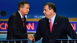 Republican presidential hopefuls, Ohio Gov. John Kasich (L) shakes hands with New Jersey Gov. Chris Christie during the Presidential debate at the Ronald Reagan Presidential Library in Simi Valley, California on September 16, 2015. Republican presidential frontrunner Donald Trump stepped into a campaign hornet's nest as his rivals collectively turned their sights on the billionaire in the party's second debate of the 2016 presidential race.