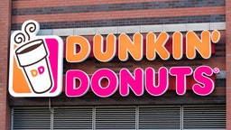 NEW YORK CITY, NEW YORK, UNITED STATES - 2015/10/17: Dunkin' Donuts sign or logo outside restaurant. Dunkin' Donuts is an American global doughnut company and coffee house chain. It was founded in 1950 by William Rosenberg.
