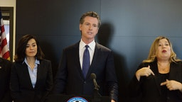 Gavin Newsom, governor of California, speaks during a news conference at the California State Capitol in Sacramento, California, U.S., on Thursday, Feb. 27, 2020. California is monitoring 8,400 people who flew into its airports from Asia and their close contacts for possible infection from the novel coronavirus, Newsom said. Photographer: Patrick Mouzawak/Bloomberg