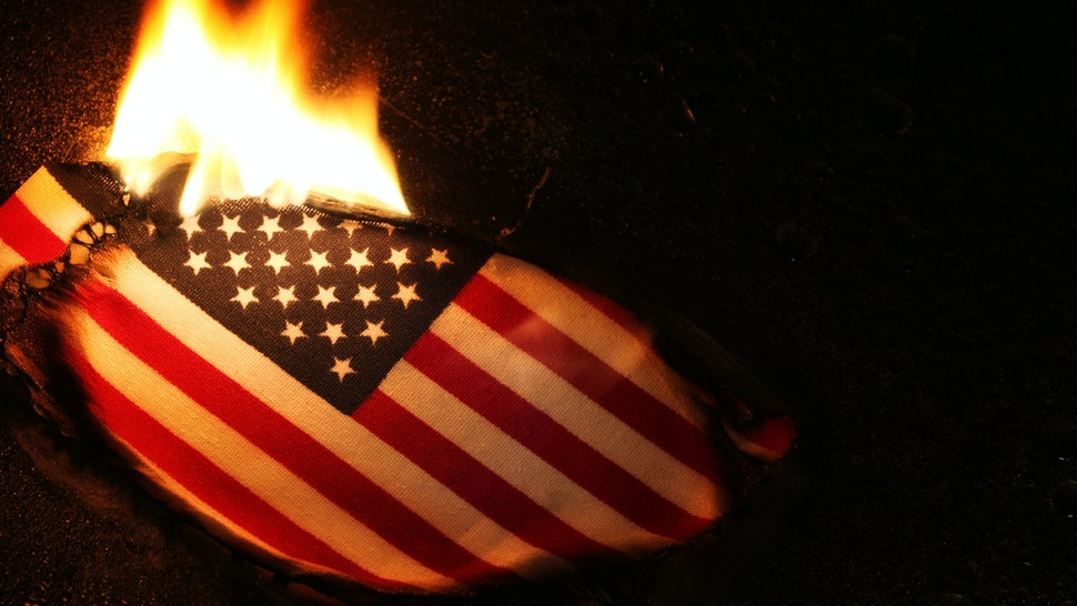 Burning American flag, perhaps in protest