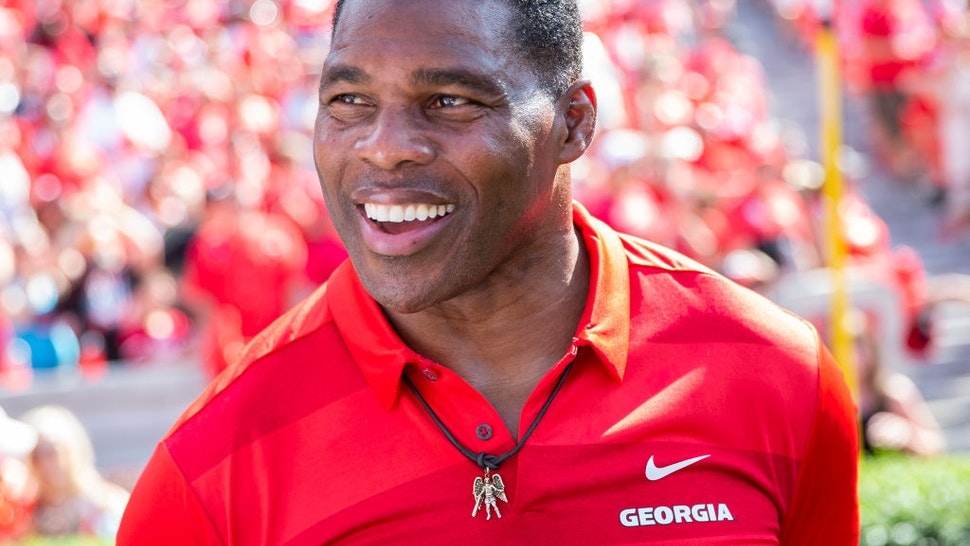 Georgia alum Herschel Walker on the sidelines during a game between Murray State Racers and University of Georgia Bulldogs at Sanford Stadium on September 7, 2019 in Athens, Georgia.