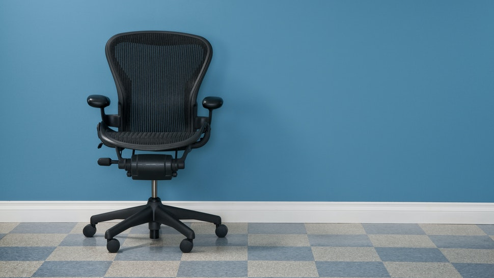 Single office chair in austere office.