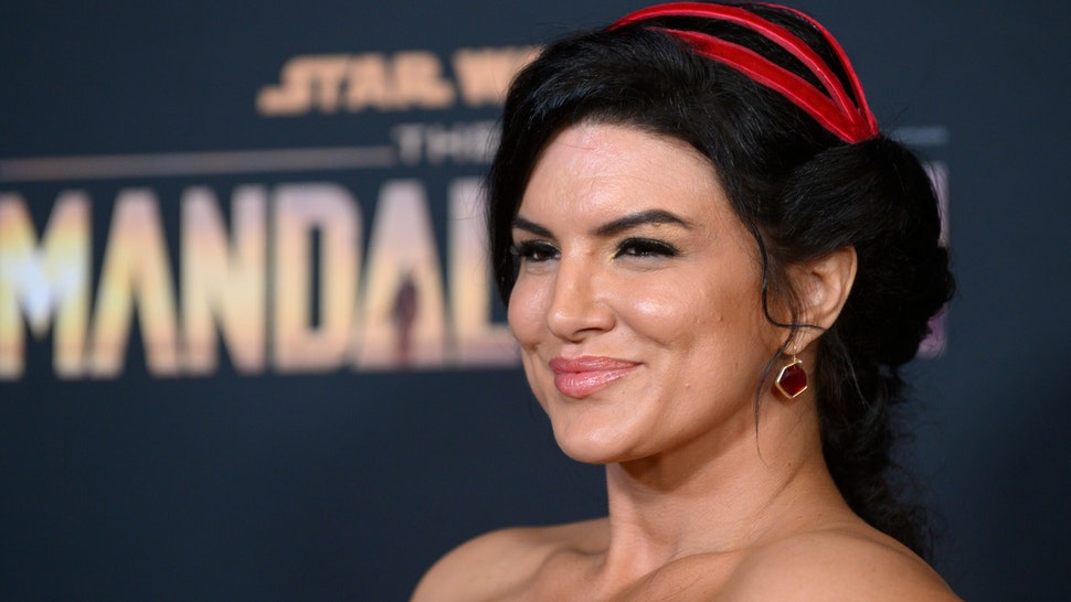 """US actress Gina Carano arrives for Disney+ World Premiere of """"The Mandalorian"""" at El Capitan theatre in Hollywood on November 13, 2019. (Photo by Nick Agro / AFP) (Photo by NICK AGRO/AFP via Getty Images)"""