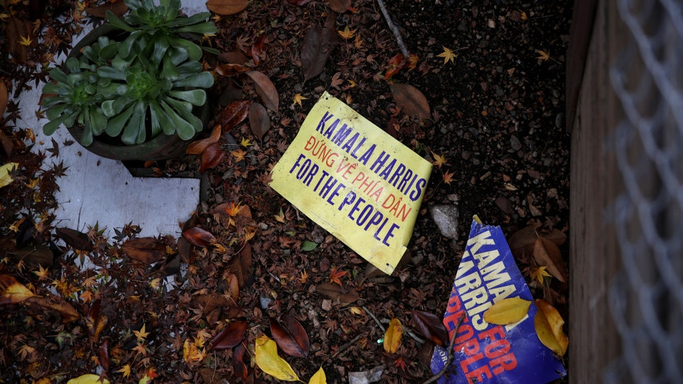 Campaign signs for democratic presidential candidate U.S. Sen. Kamala Harris (D-CA) sit on the ground outside of her Oakland campaign office on December 03, 2019 in Oakland,