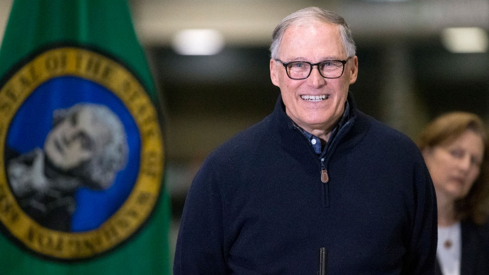 Washington State Governor Jay Inslee and other leaders speak to the press on March 28, 2020 in Seattle, Washington.