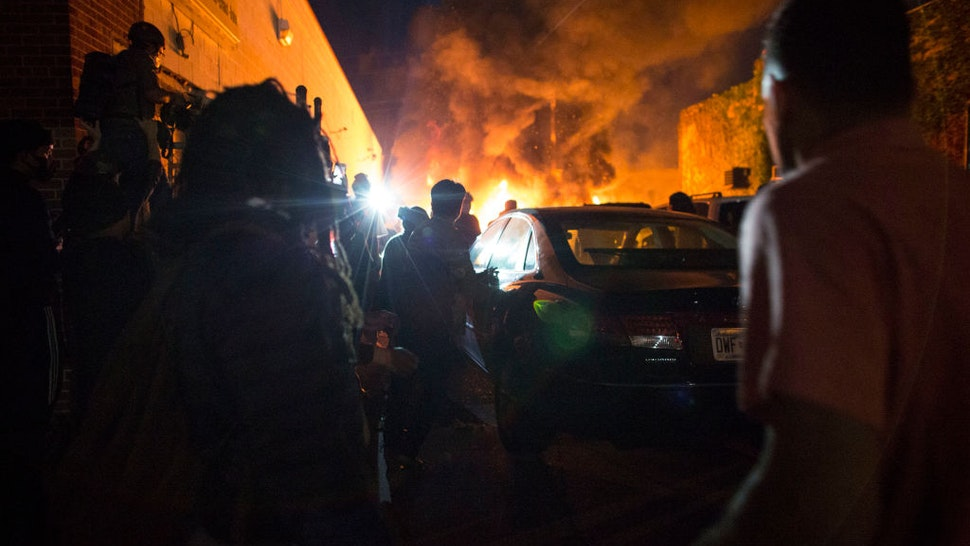 Protesters set fire to a car lot on the corner of Lake street and Park Ave. on Friday night, May 29, 2020. Protesting continues for a third day in response to the death of George Floyd.
