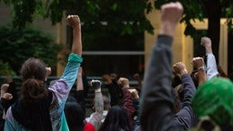 Protesters gather at the Seattle Police Department's West Precinct after marching from the police-free zone known as the Capitol Hill Organized Protest (CHOP) on June 15, 2020 in Seattle, Washington.