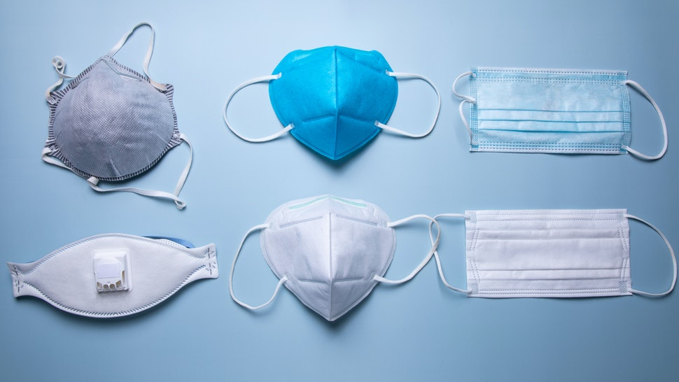 different types of protective face mask against blue background - stock photo
